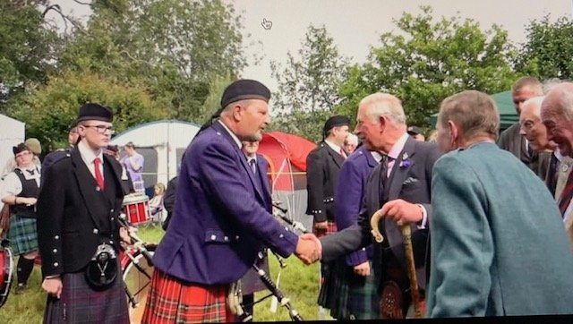 Pipe Major shakes hands with Prince Charles